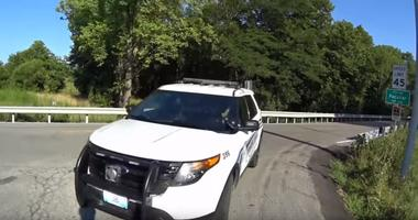 A screenshot of the video from  Joe Fasanello as the Peculiar Police SUV turns, moments before the officer crashes into Fasanello