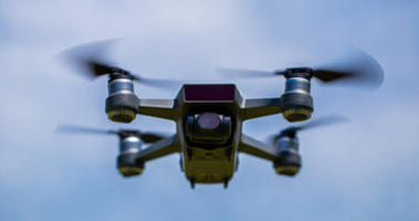Small drones are flying in the sky