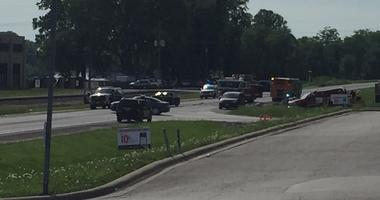 Police cars and ambulances surround the scene of a fatal crash on MO 9 Highway in Parkville