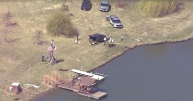 Investigators search a rural pond in Ridgely, Missouri where two 3-year-old children died Monday