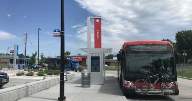 Under a sunny sky, buses are waiting at the new KCATA transit center