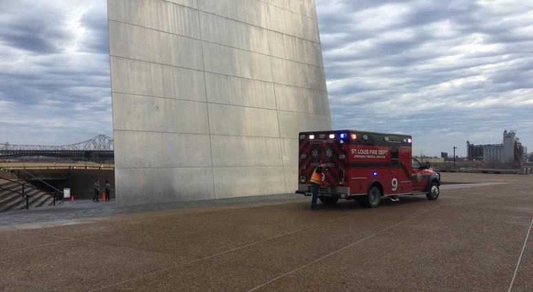 ambulance pulls away from the Arch