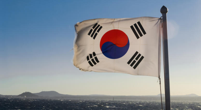 South Korea flag waving against clean blue sky, close up, with clipping path mask alpha channel transparency