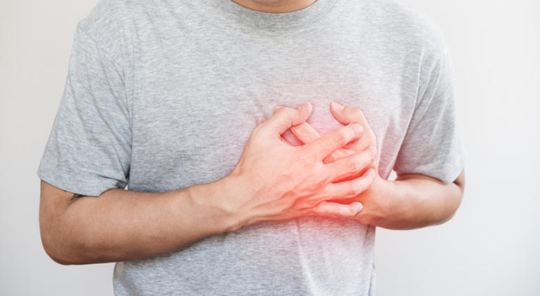 A man touching his heart, with red highlight of heart attack, and others heart disease concept, on white backgrounds
