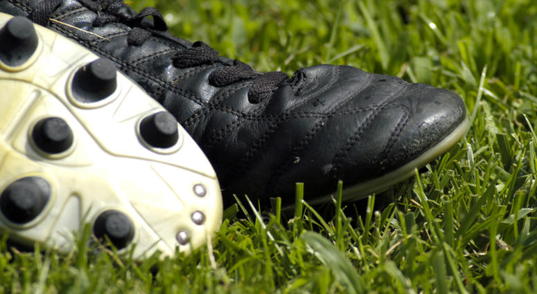 Soccer or football cleats in grass