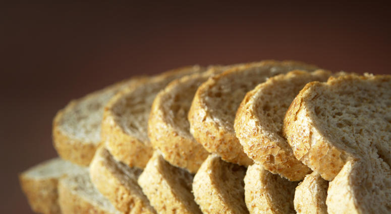 Sliced Bread on brown background