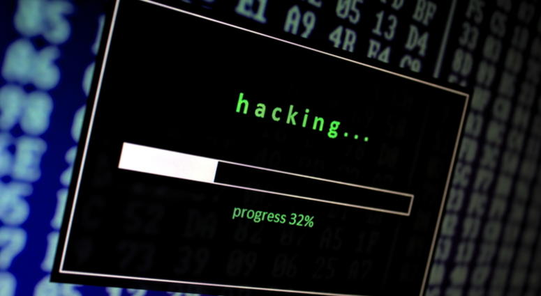 a computer screen shows a hacking progress bar