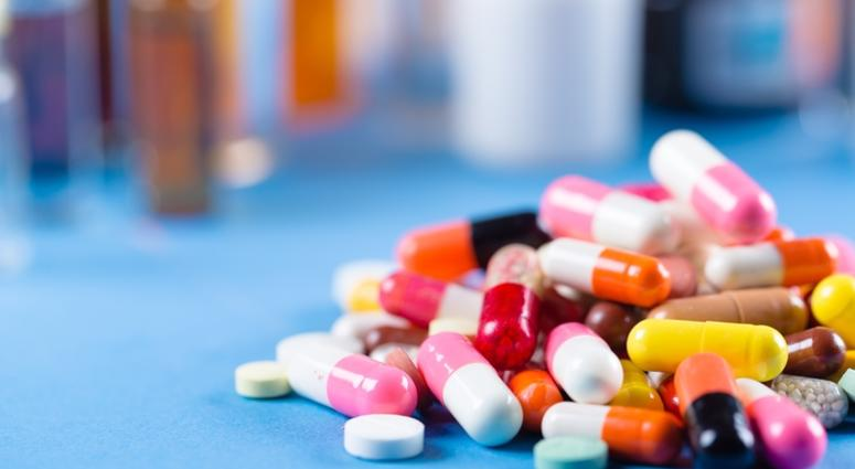 a pile of colorful prescription drugs