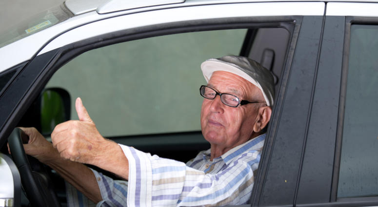Old man driving car