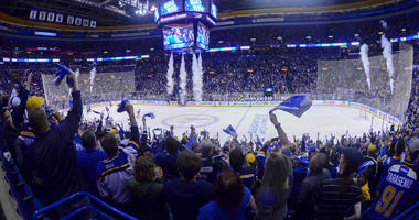 St. Louis Blues fans celebrate after a Blues victory at Scottrade Center.