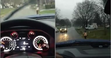 Bryan Thornhill posted a video on Facebook of his young son running to school in the rain.