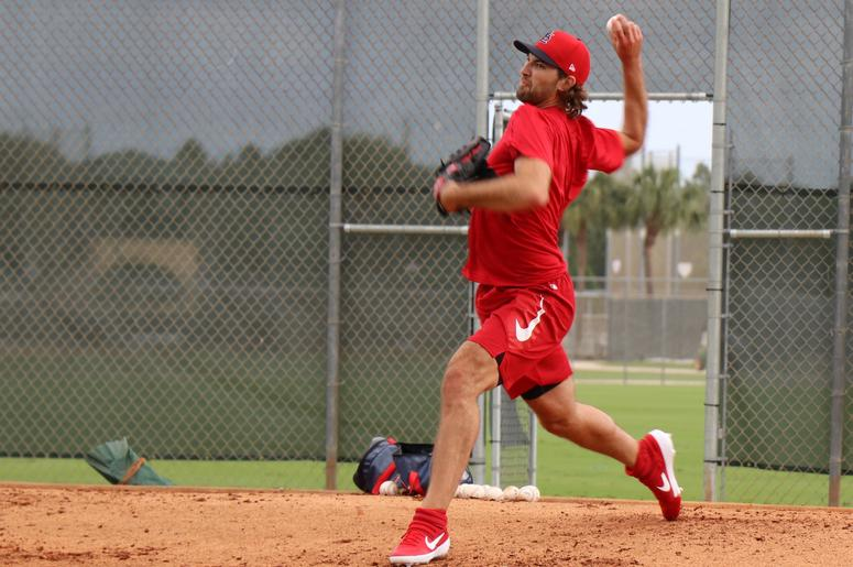 Starting pitcher Michael Wacha throws a bullpen session.