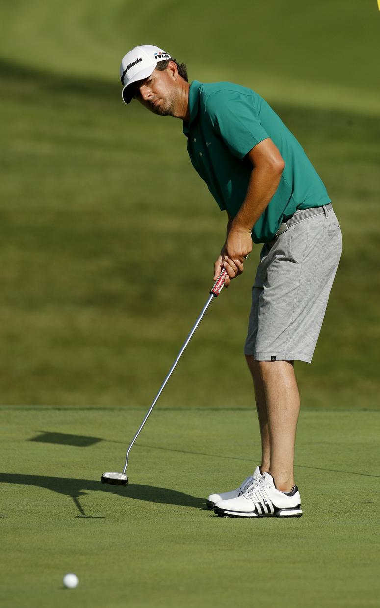 Zach J. Johnson practices on the 10th green for the PGA Championship