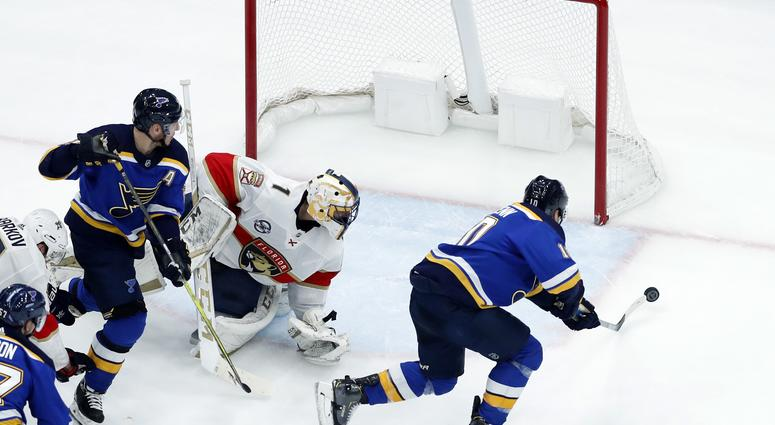 St. Louis Blues' Brayden Schenn, right, scores past Florida Panthers goaltender Roberto Luongo as Blues' Alexander Steen, left, watches during the third period of an NHL hockey game, Tuesday, Dec. 11, 2018, in St. Louis. The Blues won 4-3. (AP Photo/Jeff