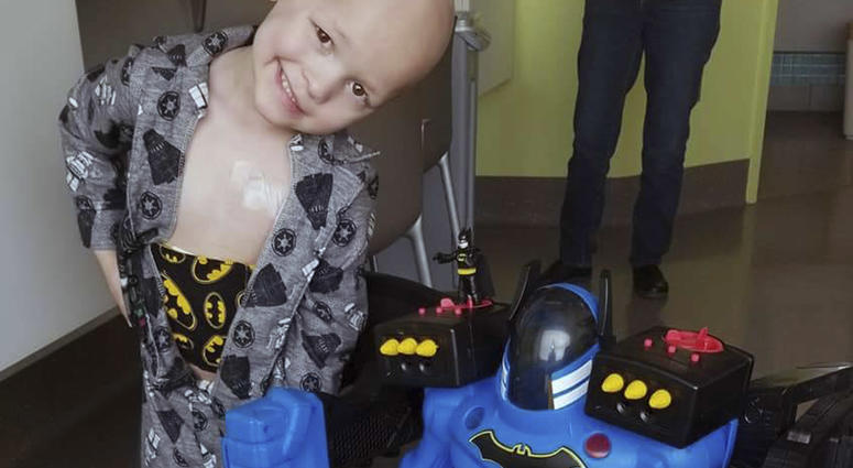 This undated photo provided by Emilie Matthias shows a photo of her son Garrett Matthias in a hospital as he receives treatment for a rare cancer in Iowa City, Iowa.