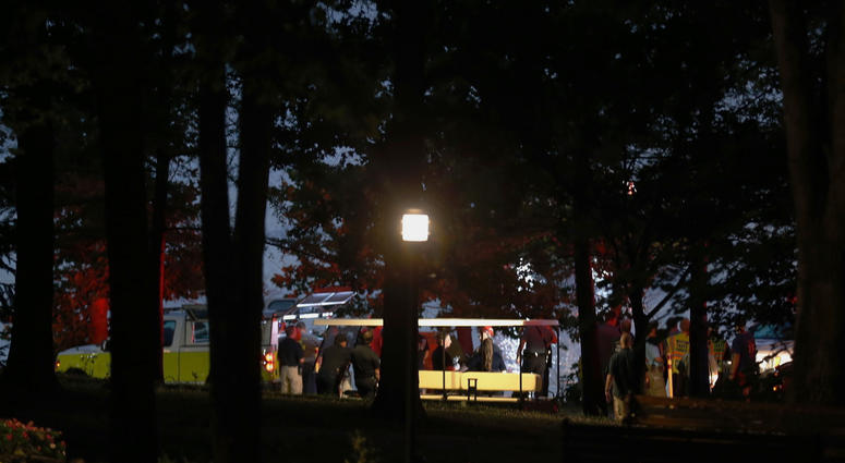Emergency responders work at Table Rock Lake after a deadly boat accident in Branson, Mo., Thursday, July 19, 2018. A sheriff in Missouri said a tourist boat has apparently capsized on the lake, leaving several people dead and several others hospitalized.