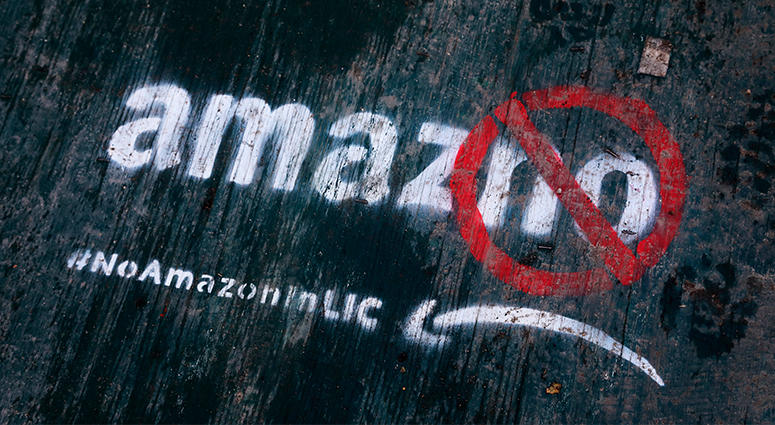 Amazon graffiti on a sidewalk by someone opposed to the location of the Amazon Headquarters in Queens, New York.