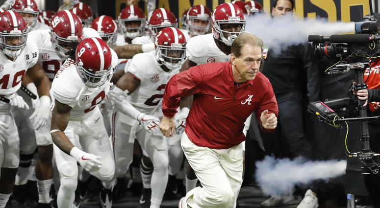Alabama head coach Nick Saban leads his team on the field before the NCAA college football playoff championship game