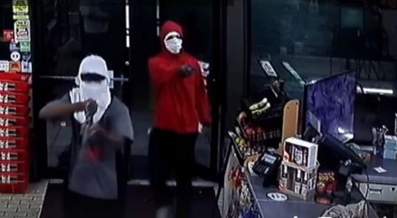 still capture from security footage showing robbers in masks