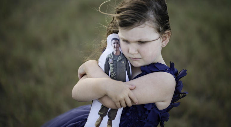 Photo of girl with her Daddy Doll.