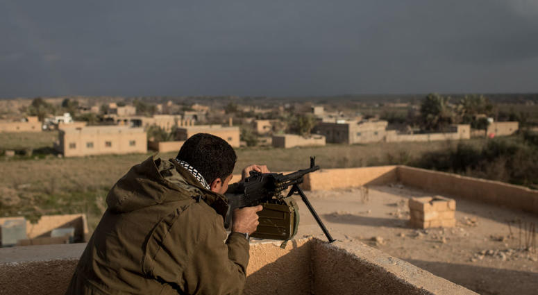 Bagouz Syria February 10 A Syrian Democratic Forces Sdf Commander Fires At A Suspected Isil Position From A Rooftop Near The Front Line On February 10