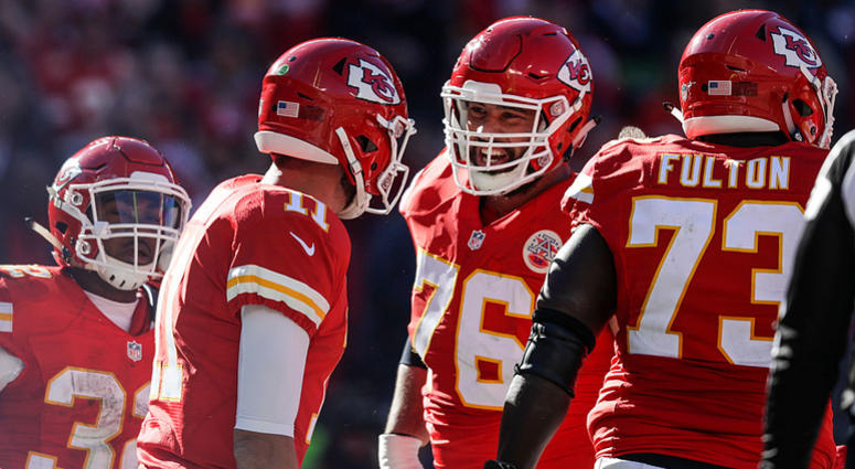 Offensive guard Laurent Duvernay-Tardif #76 of the Kansas City Chiefs celebrates with Alex Smith #11 after Smith slid in to the end zone scoring the games first touchdown against the Tampa Bay Buccaneers at Arrowhead Stadium during the second quarter of t