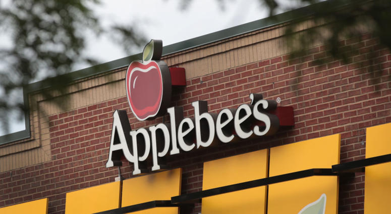 An Applebee's restaurant serves customers on August 10, 2017 in Chicago, Illinois. DineEquity, the parent company of Applebee's and IHOP, plans to close up to 160 restaurants in the first quarter of 2018. The announcement helped the stock climb more than