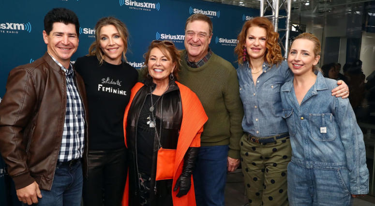 Actors Michael Fishman, Sarah Chalke, Roseanne Barr, John Goodman, SiriusXM host Sandra Bernhard and Lecy Goranson pose for photos during SiriusXM's Town Hall with the cast of Roseanne on March 27, 2018 in New York City.