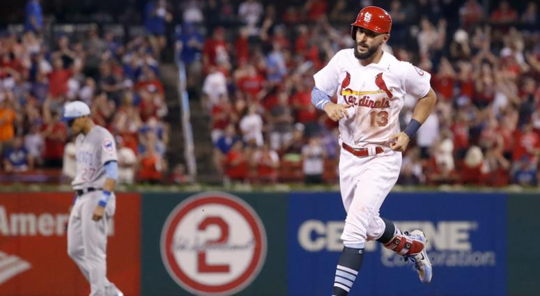 Matt Carpenter rounds the bases after hitting a home run against the Cubs.