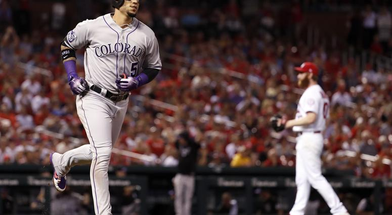 Colorado Rockies' Carlos Gonzalez, left, rounds the bases after hitting a two-run home run off St. Louis Cardinals relief pitcher John Brebbia during the seventh inning of a baseball game Tuesday, July 31, 2018, in St. Louis.