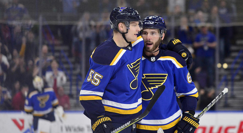 St. Louis Blues defenseman Joel Edmundson (6) is congratulated by defenseman Colton Parayko