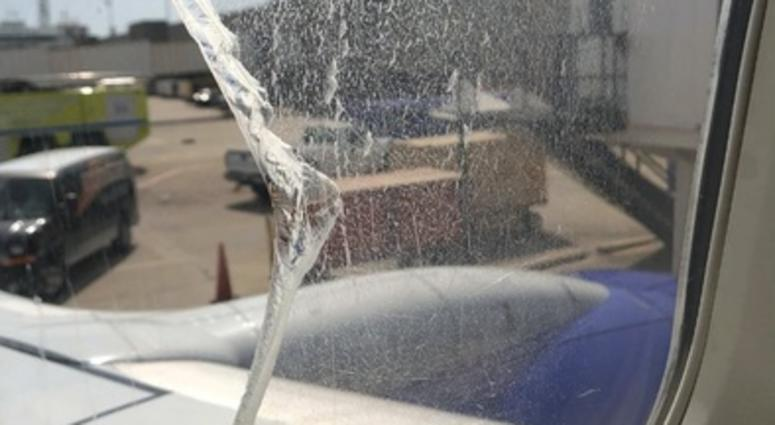Photo from a Twitter post by user @ChaikelK reportedly showing images of a damaged window from Southwest Airlines flight 957.