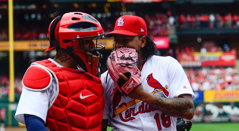 St. Louis Cardinals starting pitcher Carlos Martinez (18) speaks with St. Louis Cardinals catcher Yadier Molina