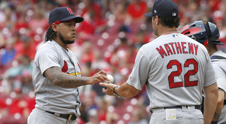 St. Louis Cardinals manager Mike Matheny (22) takes the ball from starting pitcher Carlos Martinez