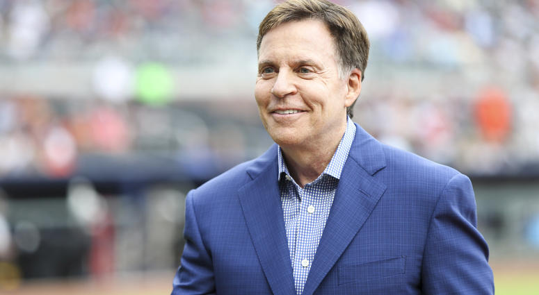 Sportscaster Bob Costas on the field before a game