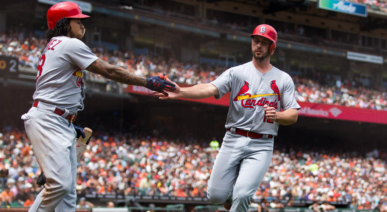St. Louis Cardinals shortstop Paul DeJong (right) celebrates with starting pitcher Carlos Martinez