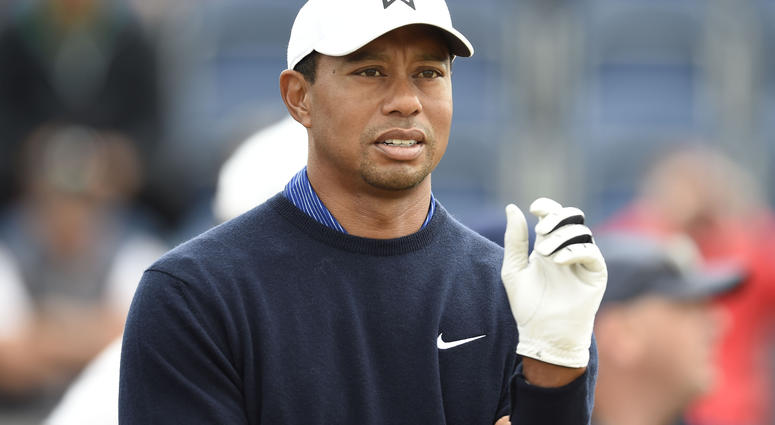 Tiger Woods waits on the 3rd tee during a practice round of The Open Championship