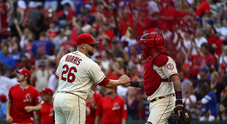 Cardinals pitcher Bud Norris and catcher Yadier Molina.