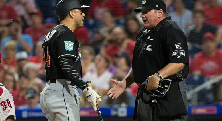 MLB umpire argues with Miami Marlins player.