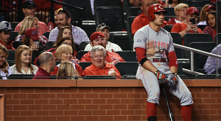 Cincinnati Reds first baseman Joey Votto (19) leans against the wall near the on deck circle during the ninth inning against the St. Louis Cardinals at Busch Stadium.