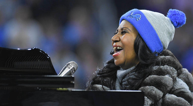 Recording artist Aretha Franklin performs during the national anthem before the game between the Detroit Lions and the Minnesota Vikings on Thanksgiving at Ford Field.