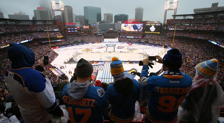 St. Louis Blues fans take photos before the Winter Classic.