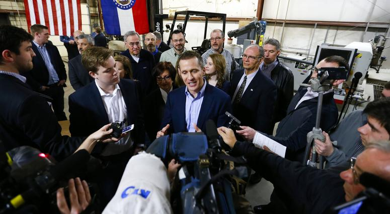 "Feb 6, 2017; Springfield, MO, USA; Missouri Gov. Eric Greitens takes questions from the media after signing legislation to make Missouri the 28th ""right-to-work"" state"