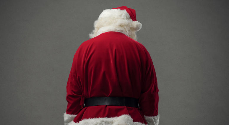 Sad Santa Claus looking down, back view, Christmas and celebrations concept