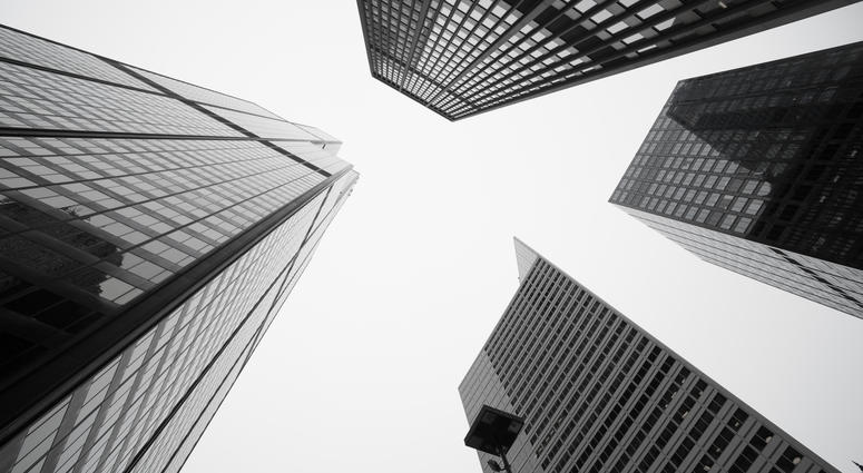 Black and white image towering Architecture and cityscapes of five Chicago buildings rising skyward Illinois USA