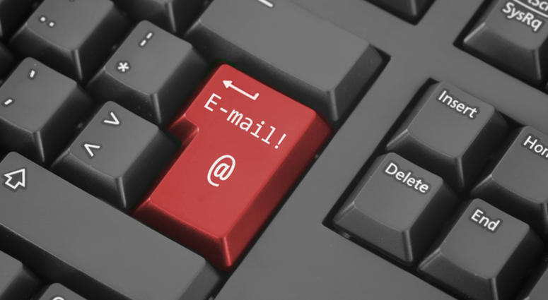 A red email button on a keyboard