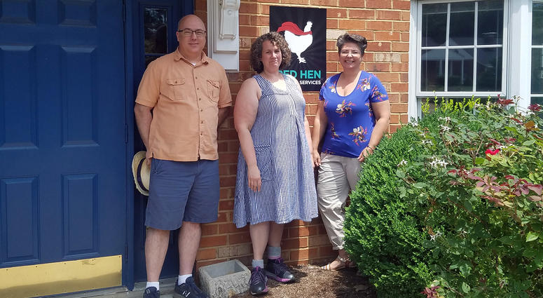 Graphic designer Mat Wilken (left), head hen/owner Cora Allen, and data and management Renee Werner stand outside their Red Hen business in Rock Hill.