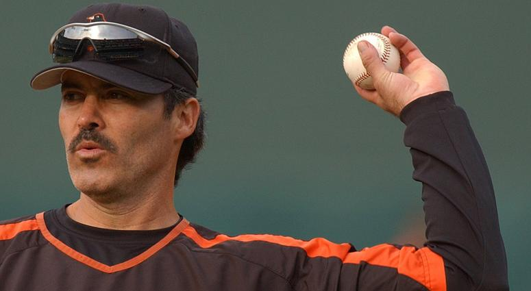 Rafael Palmeiro of the Baltimore Orioles returns a ball during batting practice before the game against the Oakland Athletics at McAfee Coliseum in Oakland, California, on August 15, 2005.