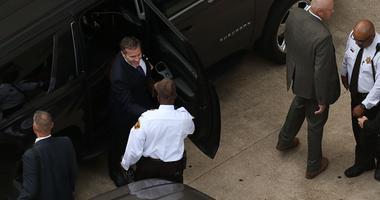 Missouri Gov. Eric Greitens, top, arrives at court for jury selection in his felony invasion of privacy trial, Thursday, May 10, 2018, in St. Louis.