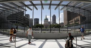 In this June 20, 2018, file photo, visitors use a new entrance to the Gateway Arch as the Old Courthouse and the rest of downtown are seen through its windows in St. Louis.